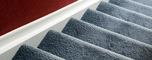 trapbekleding tapijt As